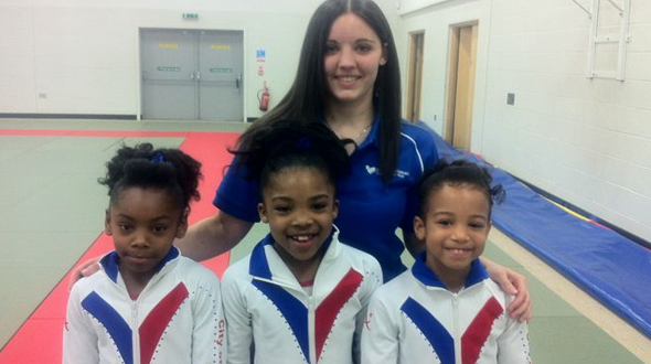 Coach Krystie With three of the City of Birmingham Artistic girls Compulsory Squad