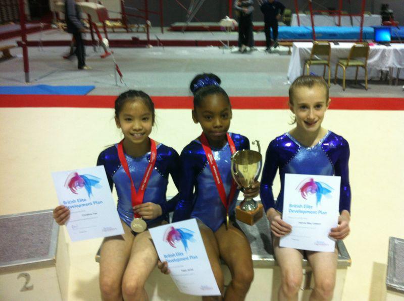 Christine, Taeja & Hannah seated on Podium