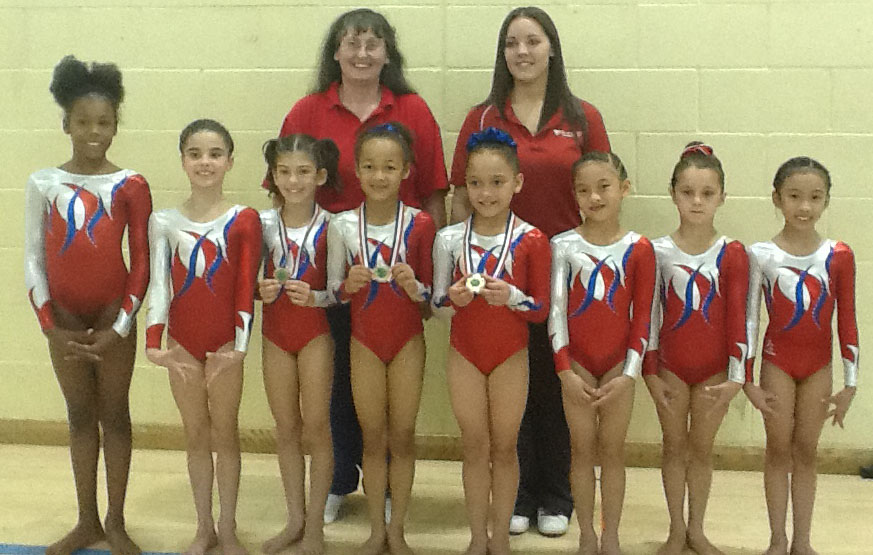 Coaches Lesley Browne & Krystie Newton with Level 5 Gymnasts Rheo, Millie, Dinah, Miriam, Sophia, Lissie, Kelsie and Serena